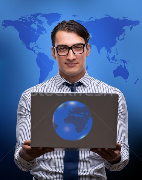 üzletember kisajtolás virtuális gombok globális üzlet számítógép Stock fotó © Elnur