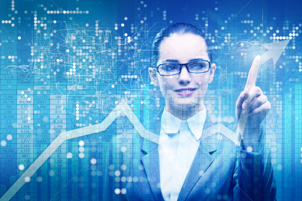 Businesswoman in stock trading business concept Stock photo © Elnur