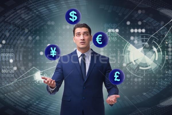 Geschäftsmann Jonglieren unterschiedlich Währungen Business Mann Stock foto © Elnur