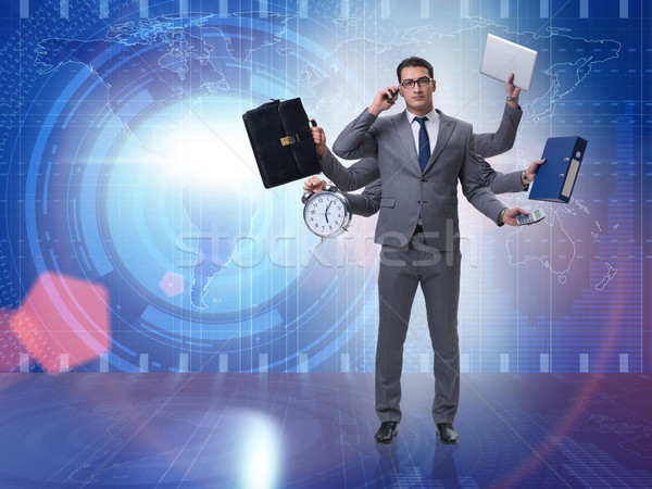 Young businessman in multitasking concept Stock photo © Elnur