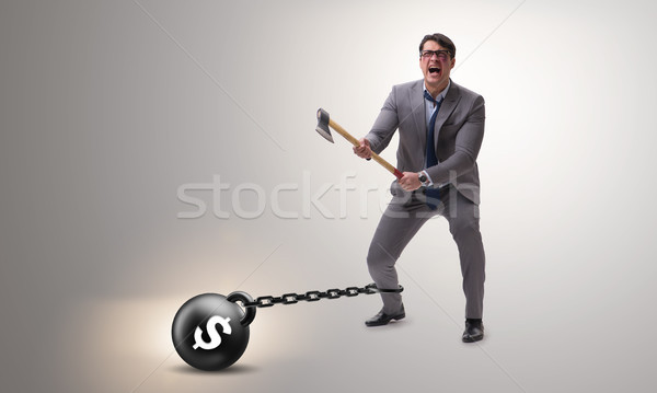 Debt concept with businessman escaping loan burden with axe Stock photo © Elnur