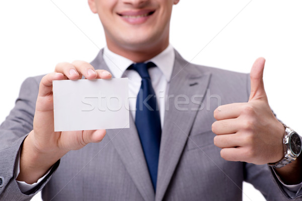 Businessman with blank card isolated on white background Stock photo © Elnur
