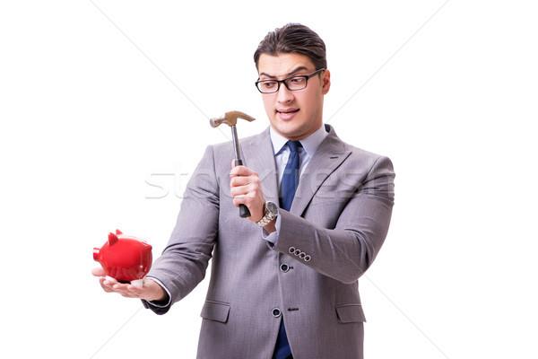 Businessman breaking piggybank isolated white background Stock photo © Elnur