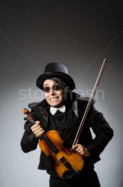 Man in musical art concept Stock photo © Elnur