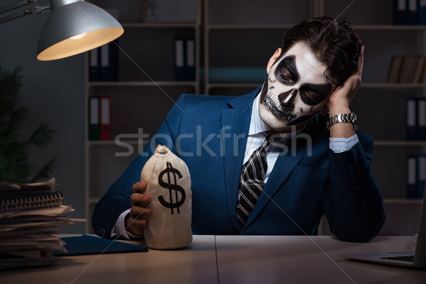 Imprenditore scary faccia maschera lavoro tardi Foto d'archivio © Elnur