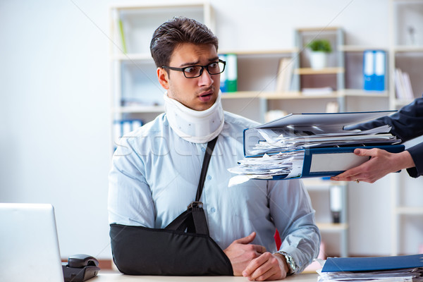 Injured man getting more work from his boss Stock photo © Elnur