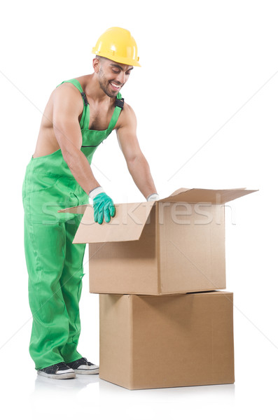 Man in green coveralls with boxes Stock photo © Elnur