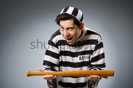 Prisoner with gun against dark background Stock photo © Elnur