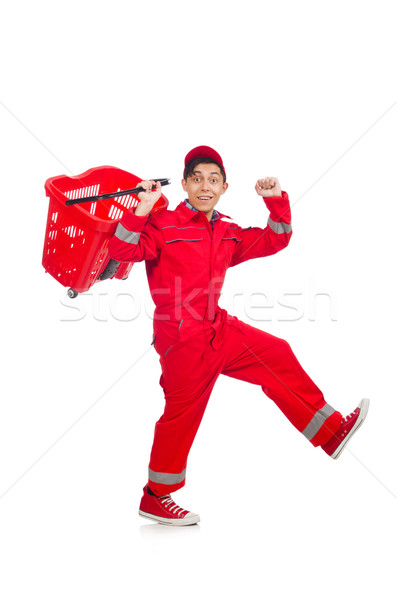 Man in red coveralls with shopping supermarket cart trolley Stock photo © Elnur