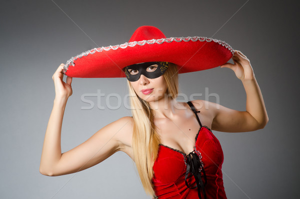 Woman wearing red sombrero and mask Stock photo © Elnur