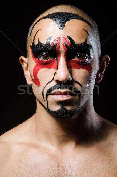 Man with face covered with facepaint Stock photo © Elnur