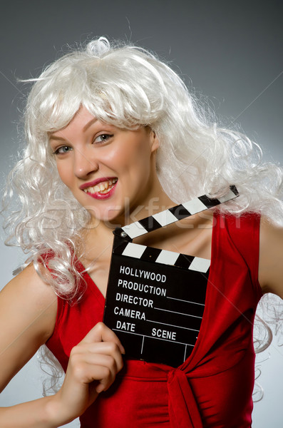 Blond woman with movie board Stock photo © Elnur