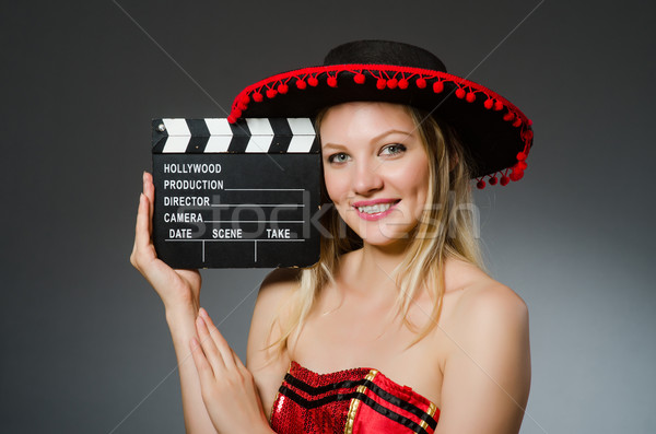 Funny mexican woman with sombrero and movie clapboard Stock photo © Elnur