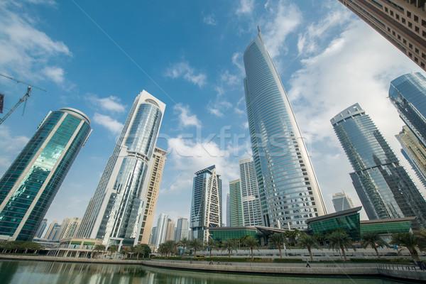 Wysoki wieżowce Dubai wody działalności niebo Zdjęcia stock © Elnur