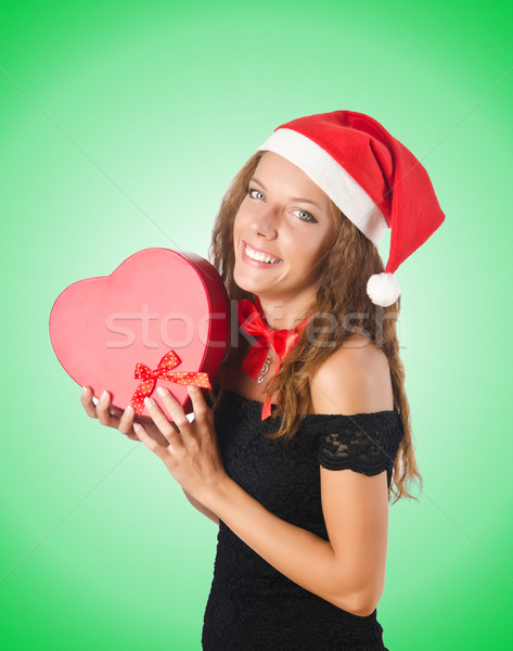 Young santa with giftbox on white Stock photo © Elnur