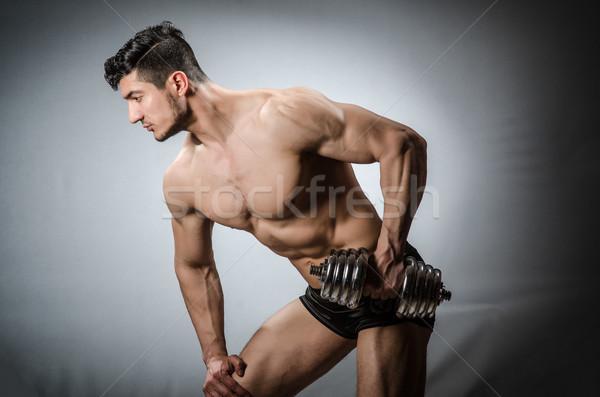 Musculaire bodybuilder haltères sport fitness santé Photo stock © Elnur