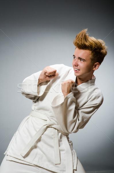 Funny karate myśliwiec biały kimono Zdjęcia stock © Elnur