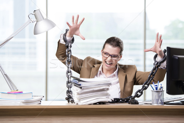 Woman chained to her working desk Stock photo © Elnur