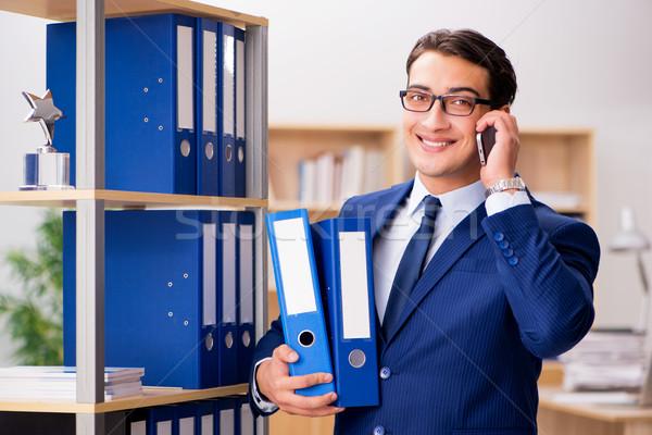 Handsome businessman speaking on mobile phone Stock photo © Elnur