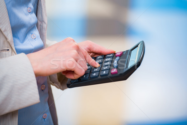 Hands calculating profit on the calculator Stock photo © Elnur