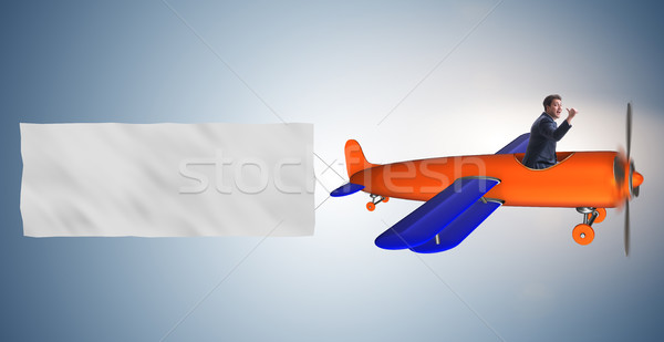 The old vintage airplane with banner ribbon Stock photo © Elnur