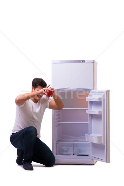голодный человека глядя деньги холодильник продовольствие Сток-фото © Elnur