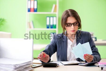 Businesswoman working in the office at desk Stock photo © Elnur