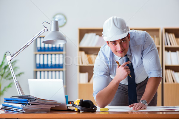 Engineer supervisor working on drawings in the office Stock photo © Elnur