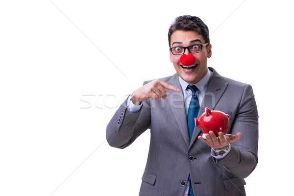 Funny clown businessman with a piggy bank isolated on white back Stock photo © Elnur