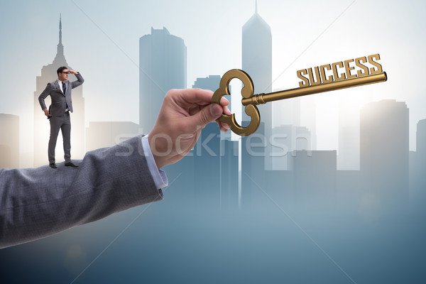 Businessman with key to success business concept Stock photo © Elnur