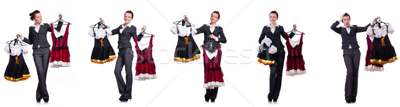 The woman with difficult choice of choosing clothing Stock photo © Elnur