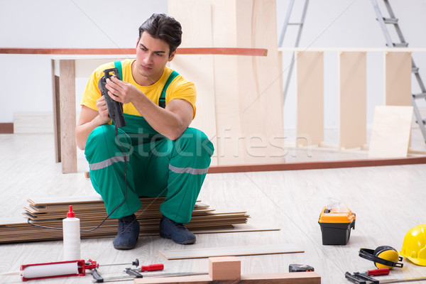 Contractor working on laminate wooden floor  Stock photo © Elnur