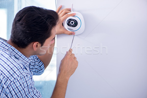 Man installing surveillance CCTV cameras at home Stock photo © Elnur