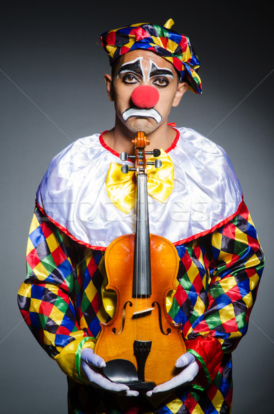 Sad clown performing at vioin Stock photo © Elnur
