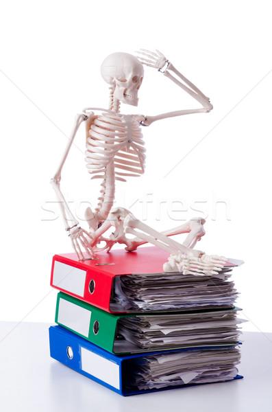 Stock photo: Skeleton with pile of files on white
