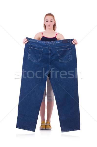 Woman with large jeans in dieting concept Stock photo © Elnur