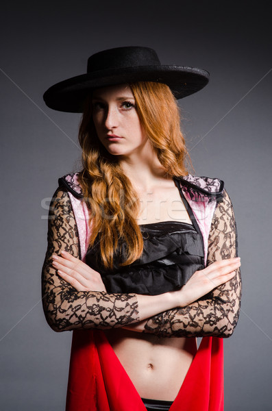 Redhead woman toreador against grey background Stock photo © Elnur