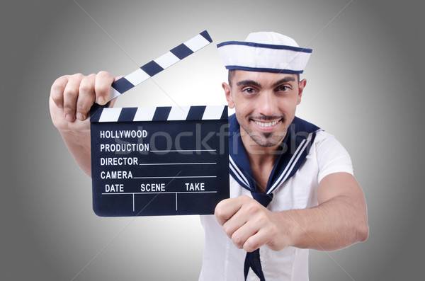 Sailor with movie clapper on white Stock photo © Elnur