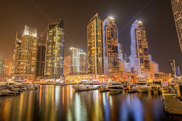 Dubai marina felhőkarcolók éjszaka iroda épület Stock fotó © Elnur