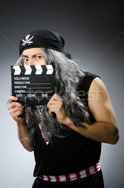 Old pirate with movie board Stock photo © Elnur