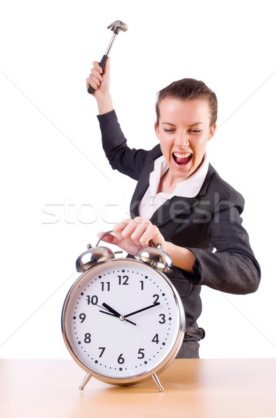 Woman desperate with time hitting clock with hammer Stock photo © Elnur