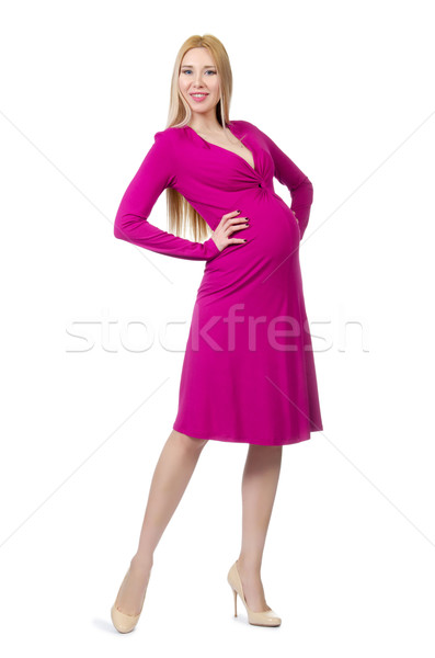 Pretty pregnant woman in pink dress isolated on white Stock photo © Elnur