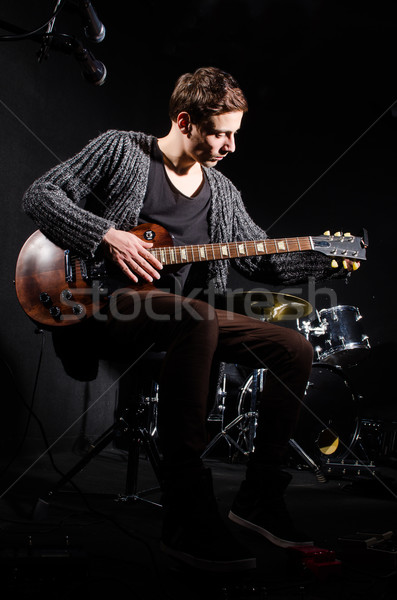 Man playing guitar in dark room Stock photo © Elnur