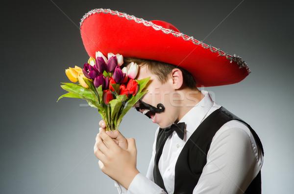 Személy visel szombréró kalap vicces virágok Stock fotó © Elnur