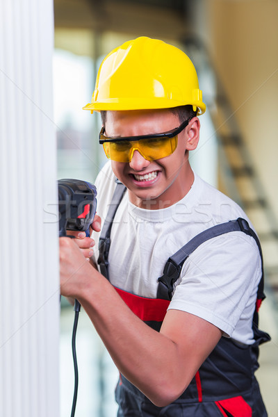 Man drilling the wall with drill perforator Stock photo © Elnur