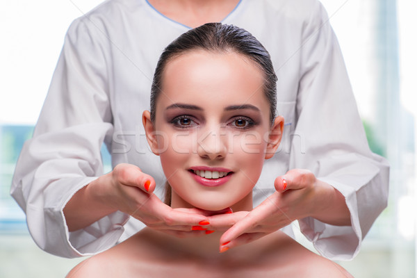 Young woman during face and skin massage session Stock photo © Elnur