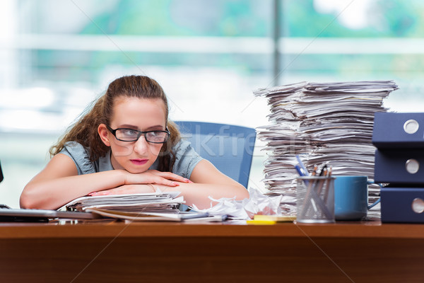 Stressed businesswoman with stack of papers Stock photo © Elnur