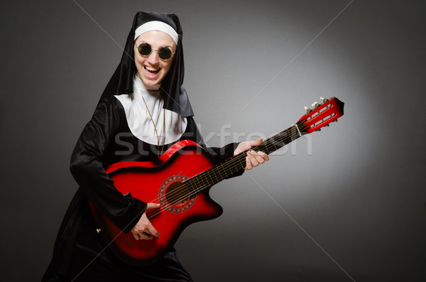 Funny nun with red guitar playing Stock photo © Elnur