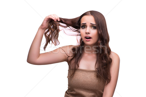 Woman checking her haircut isolated on white Stock photo © Elnur