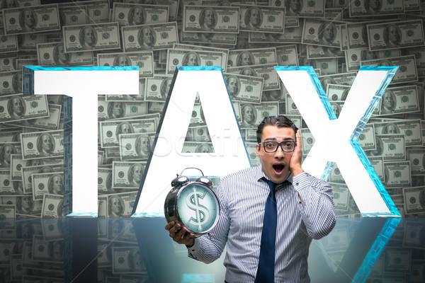 Businessman fearful of high taxes Stock photo © Elnur